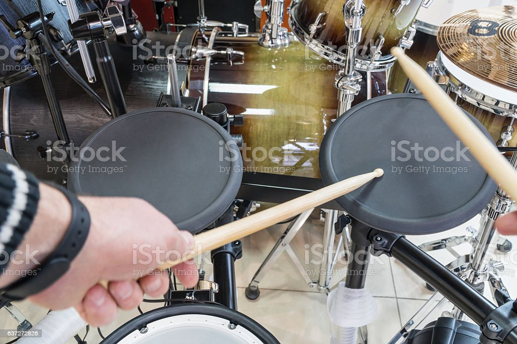 Drummer knocks on electric drum stock photo