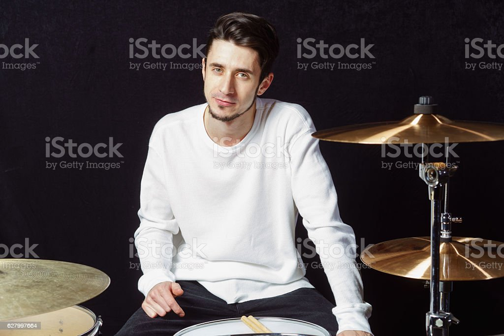 Drummer man to play the drums. white background stock photo