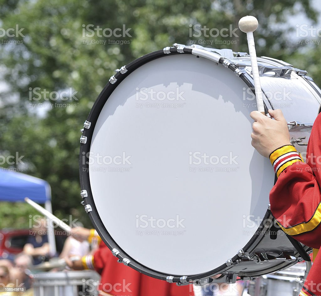 Drummer Playing Bass Drum in Parade stock photo