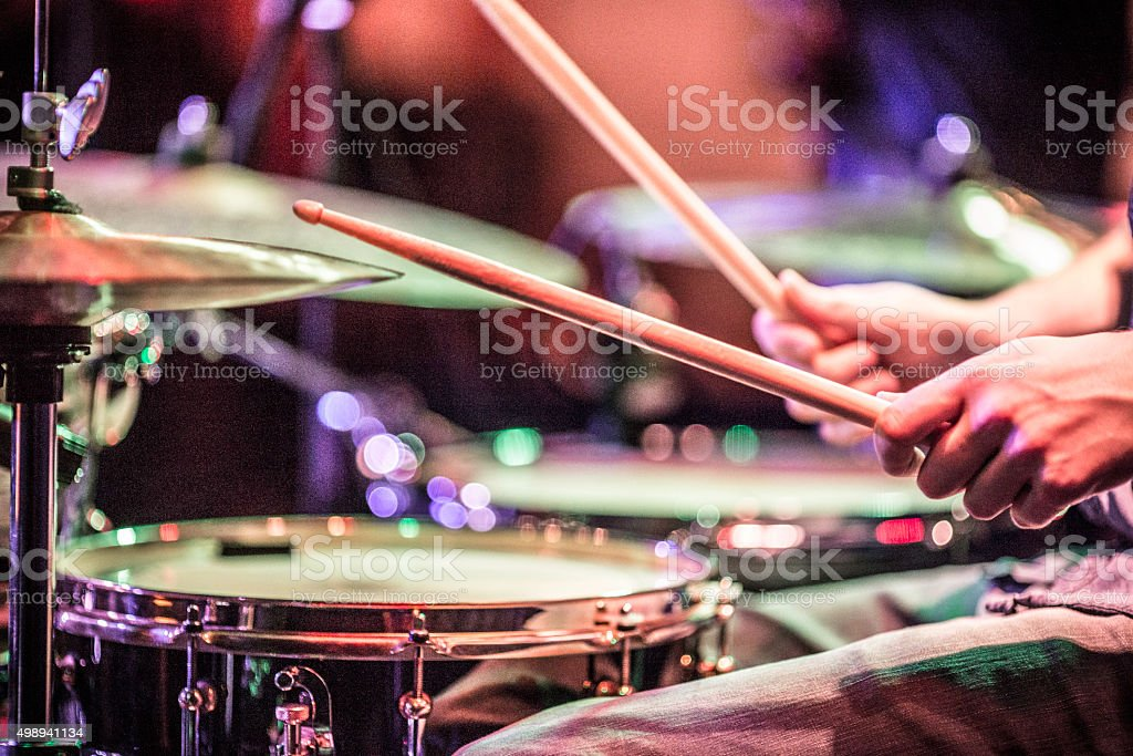 Drummer playing drums on stage stock photo