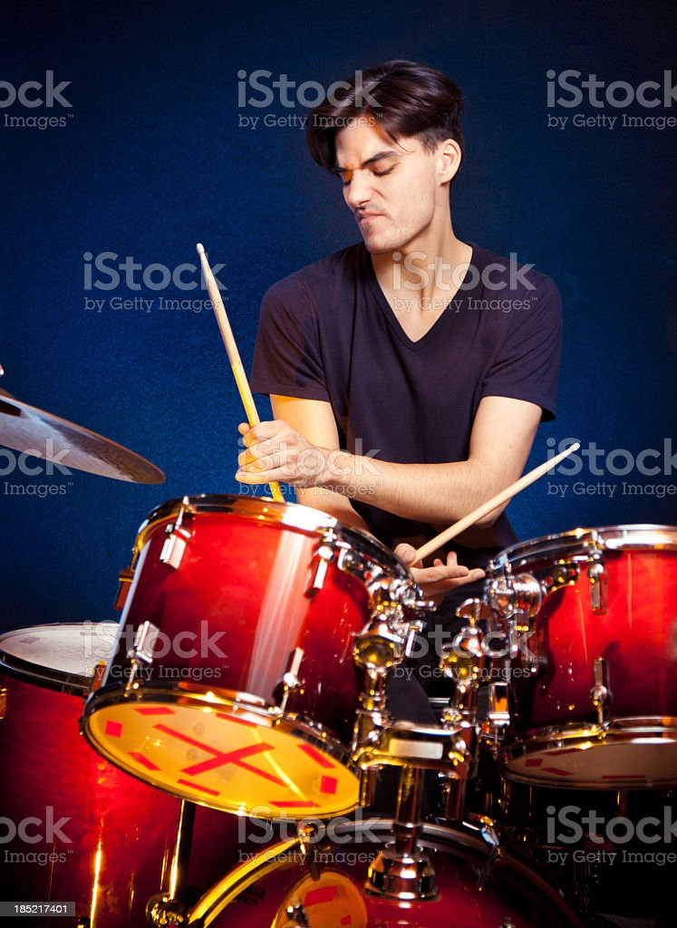 Drummer playing drums stock photo