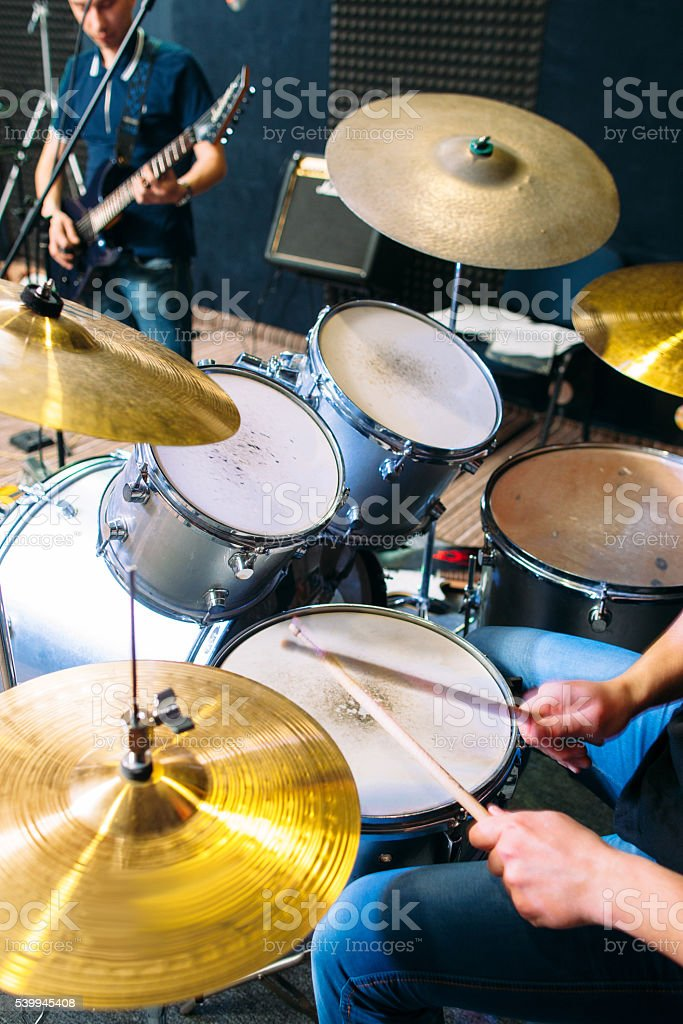 Drummer plays on drum set alive close-up stock photo