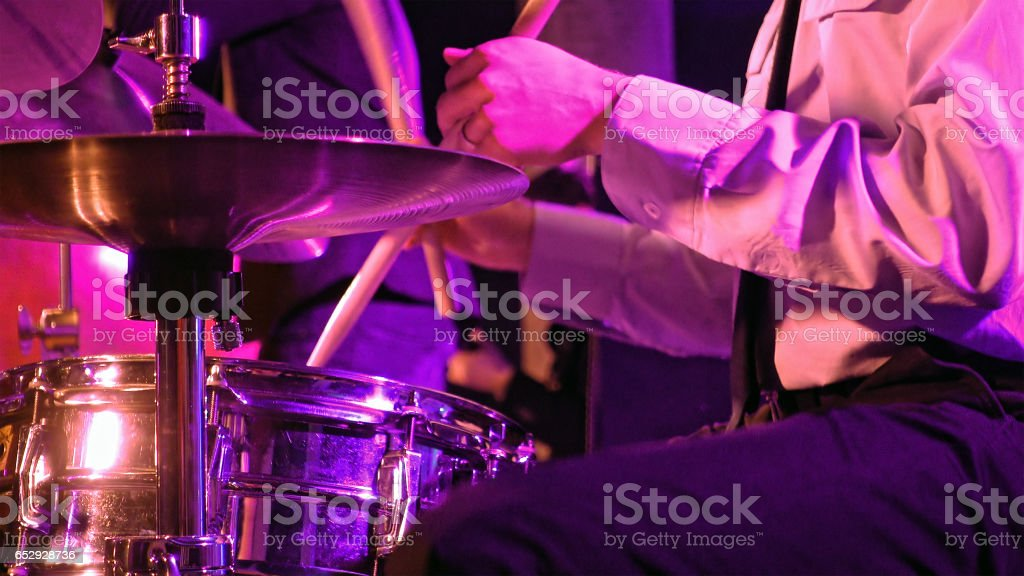 Drummer plays on drum set and cymbal stock photo
