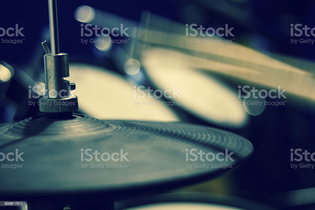 Drummer practicing with Cool blue tones stock photo