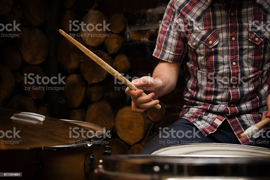 Drummer with sticks and drums stock photo