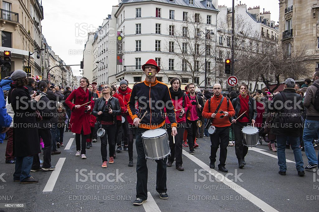 Drummers in red black costume at the Carnival of Paris. stock photo