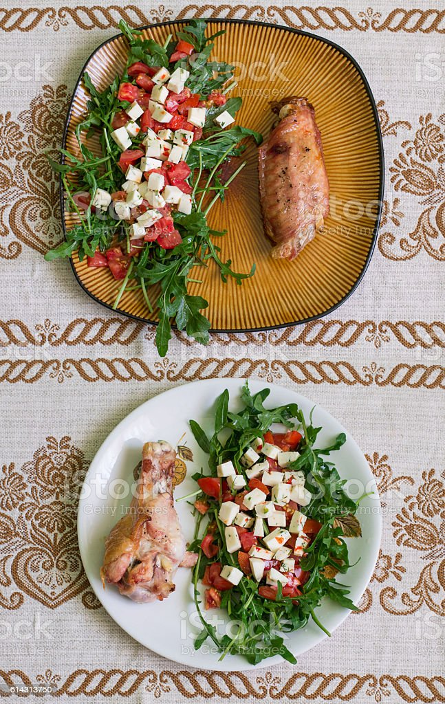 Drumstick and wing of turkey and salad stock photo