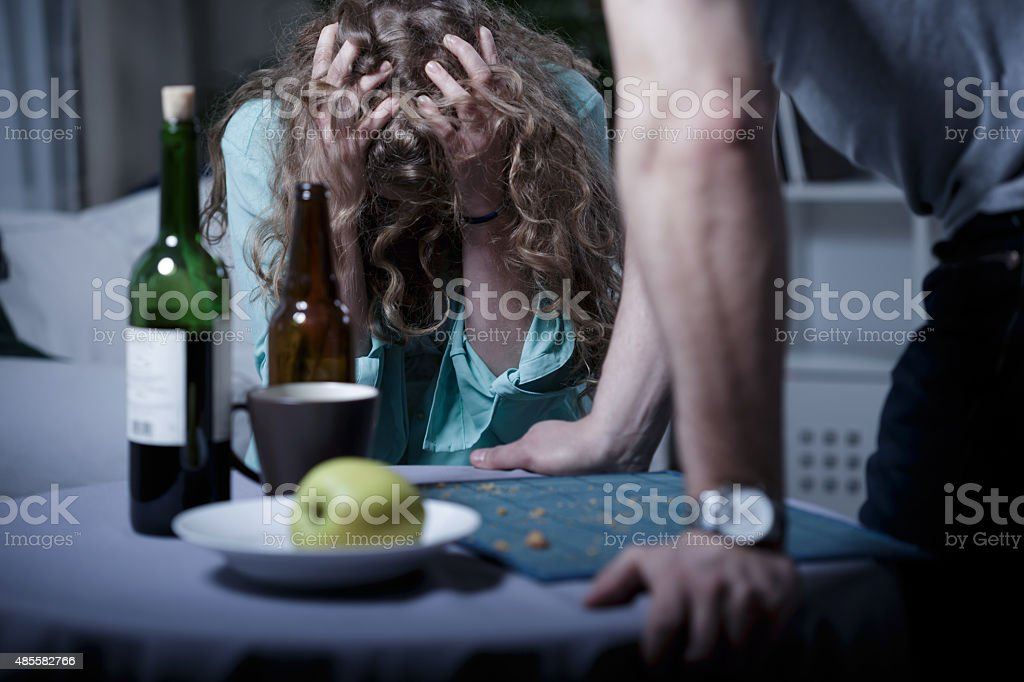 Drunk aggressive husband stock photo