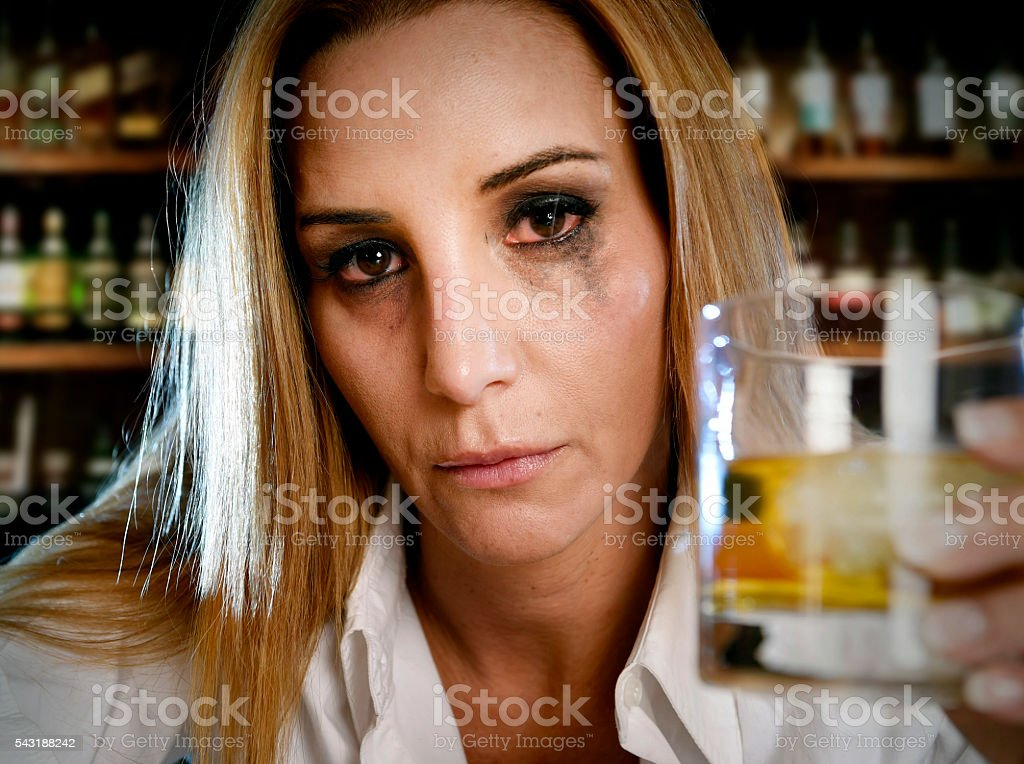 drunk alcoholic running mascara woman wasted drinking in bar stock photo