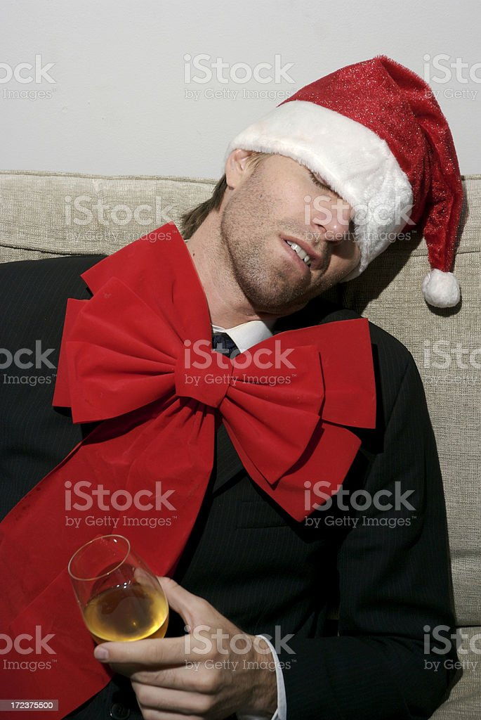 Drunk Businessman in Santa Hat and Holiday Red Bow Tie royalty-free stock photo