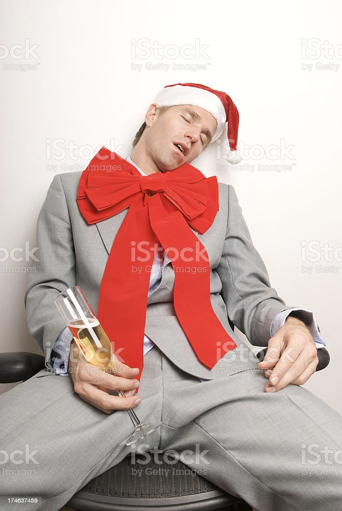 Drunk Businessman Passed Out at Holiday Office Party royalty-free stock photo
