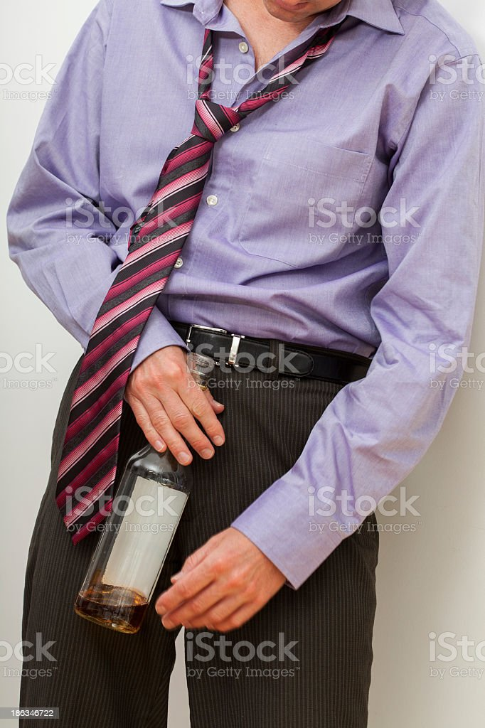 Drunk businessman with whisky royalty-free stock photo