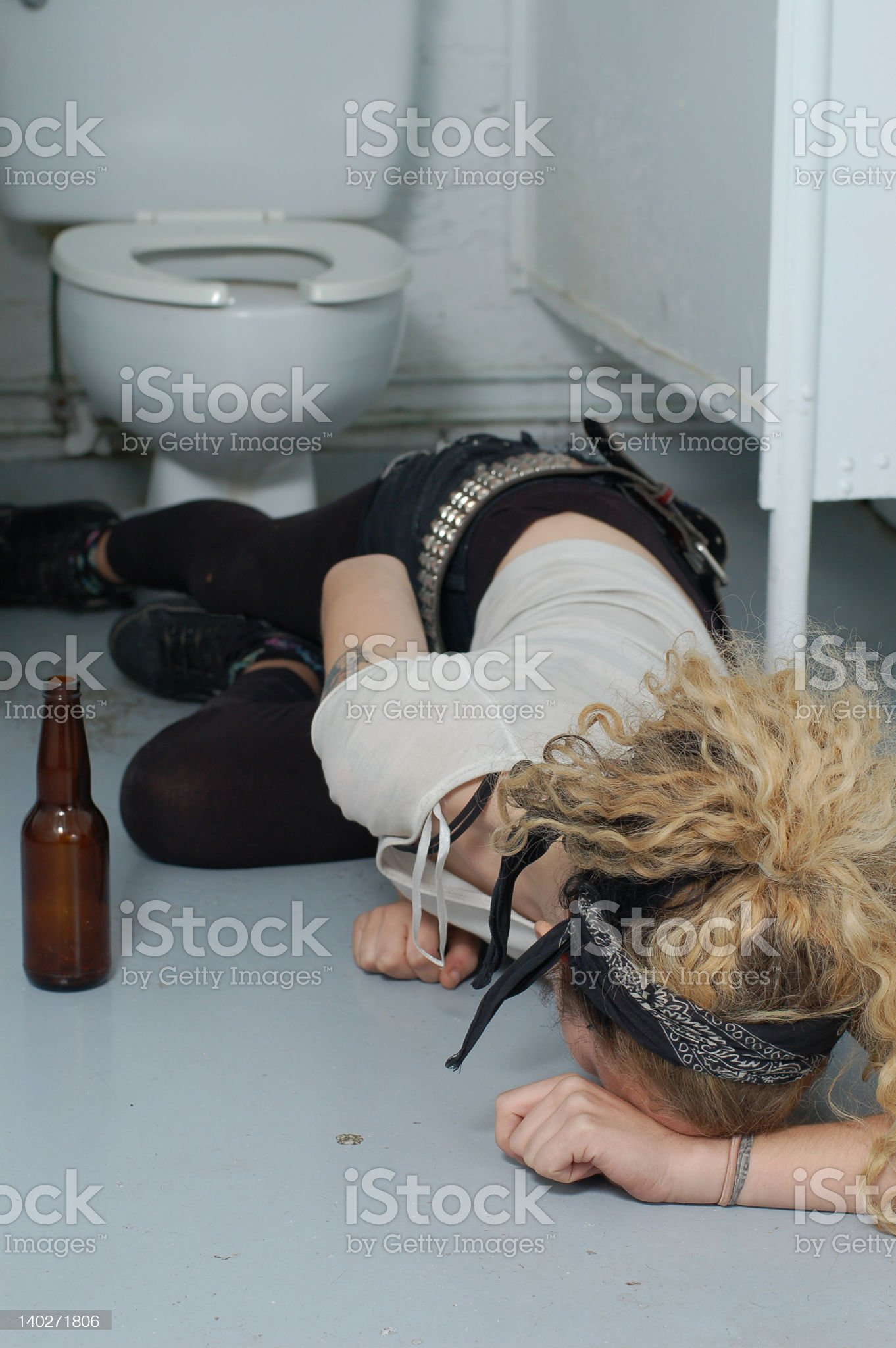 Drunk girl in a public toilet royalty-free stock photo