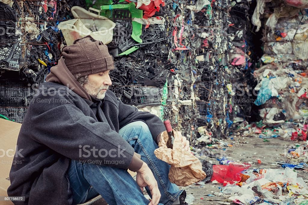 Drunk Homeless in Landfill stock photo