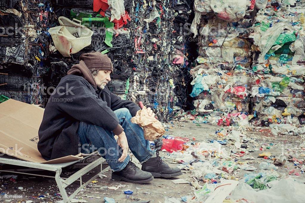 Drunk Homeless in Landfill stock photo