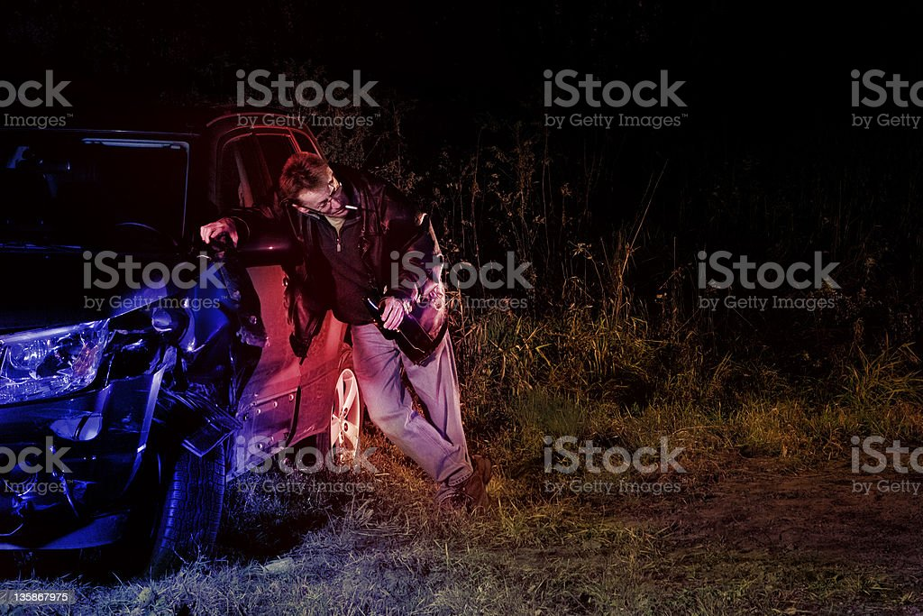 Drunk man after a hit and run stock photo