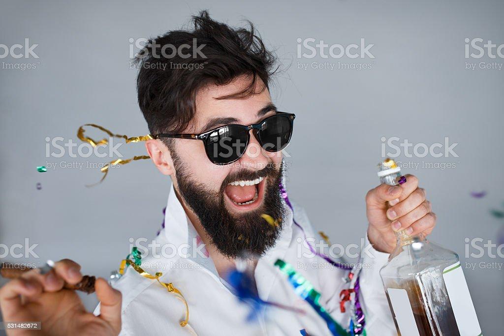drunk man having fun at wild party stock photo