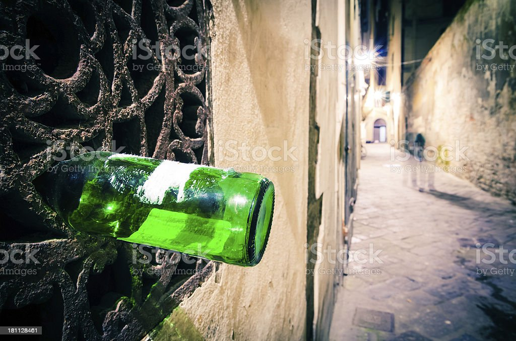 Drunk man in an old alley of Florence, Italy royalty-free stock photo