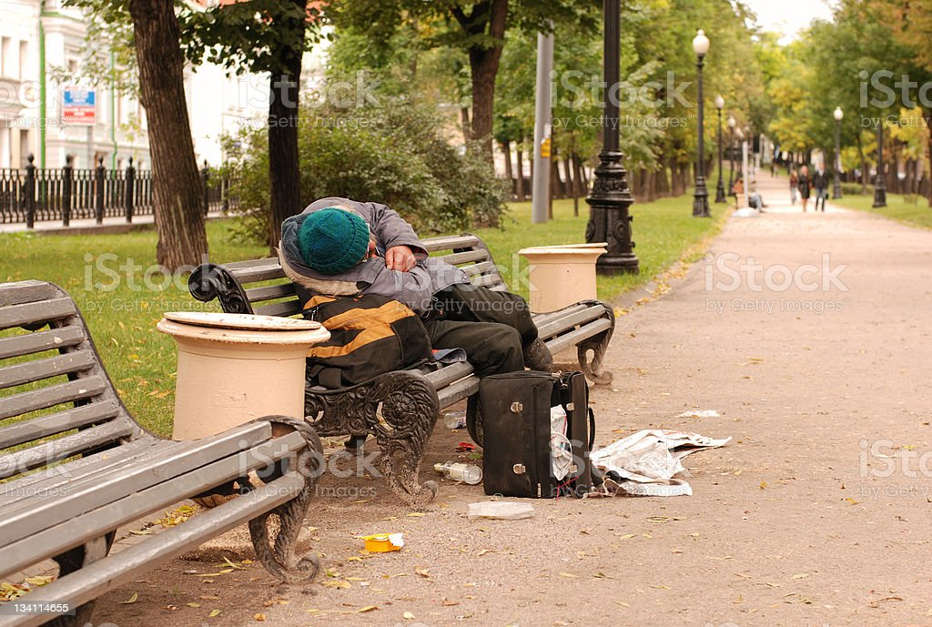 Drunk man on the park bench royalty-free stock photo