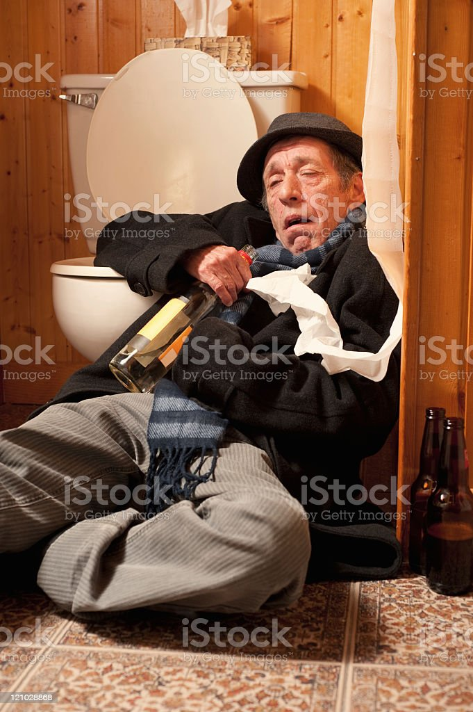 Drunk man passed out royalty-free stock photo
