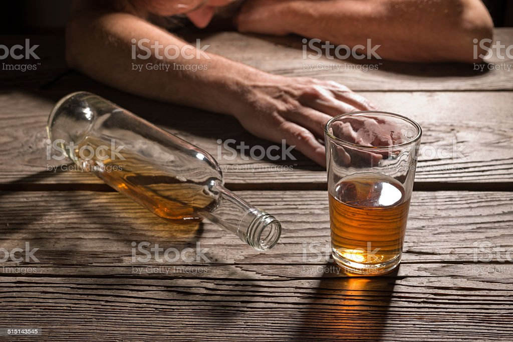 drunk man with a glass of brandy stock photo