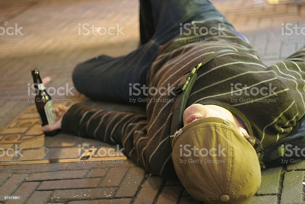 Drunk on Sidewalk stock photo