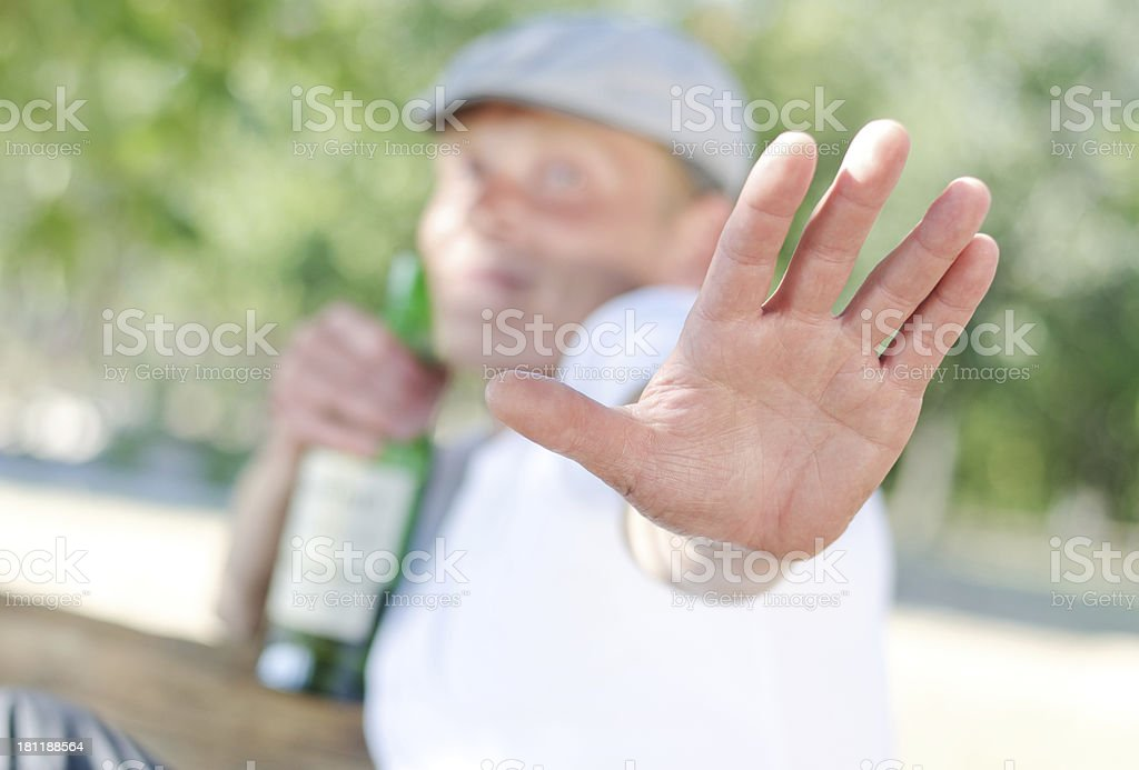 Drunk protecting his drink stock photo