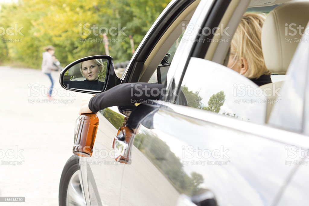 Drunk woman driver about to hit a pedestrian royalty-free stock photo