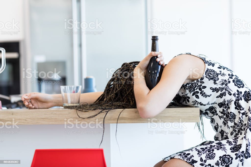 Drunk woman with bottle stock photo