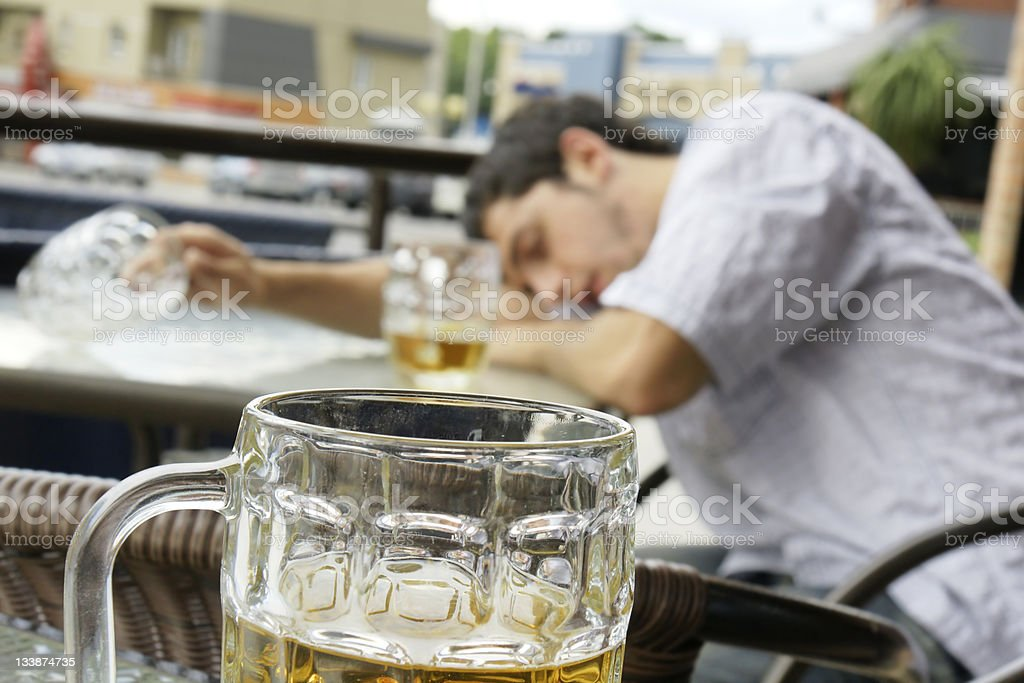 Drunk young man shallow DOF stock photo