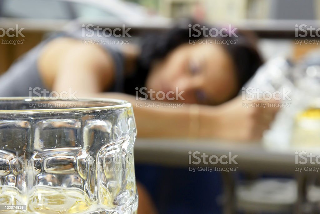 Drunk young woman shallow DOF stock photo