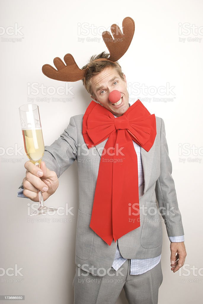 Drunken Businessman with Reindeer Antlers Holds Up a Toast royalty-free stock photo