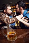 Drunken male quarrel in bar