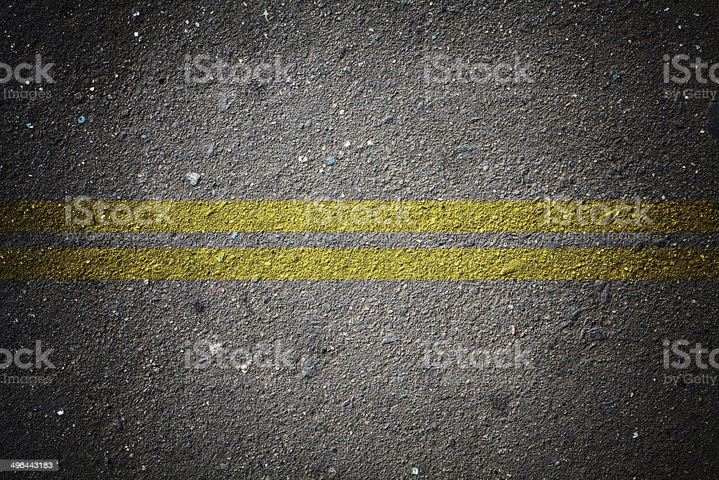 dry asphalt texture with double solid line stock photo
