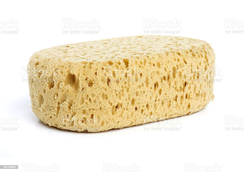 A dry bath sponge that is rectangular and cylindrical stock photo