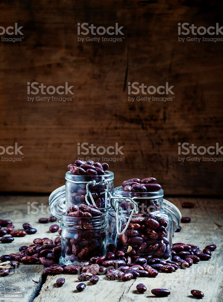 Dry beans in a glass jar stock photo