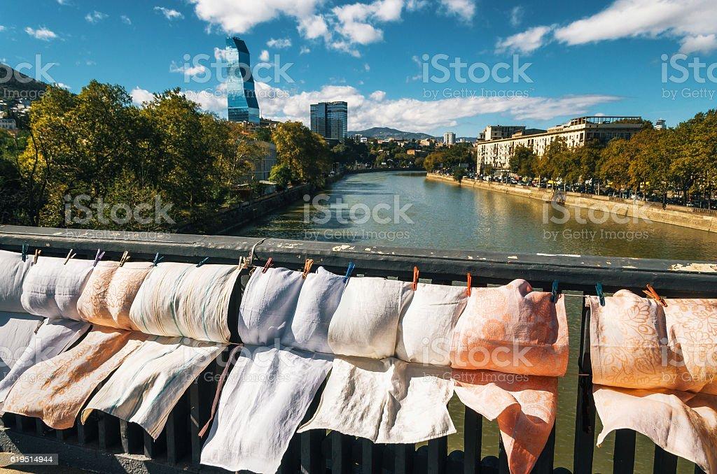 Dry bridge flea market against Kura river and skyscrapers, Tbilisi стоковое фото