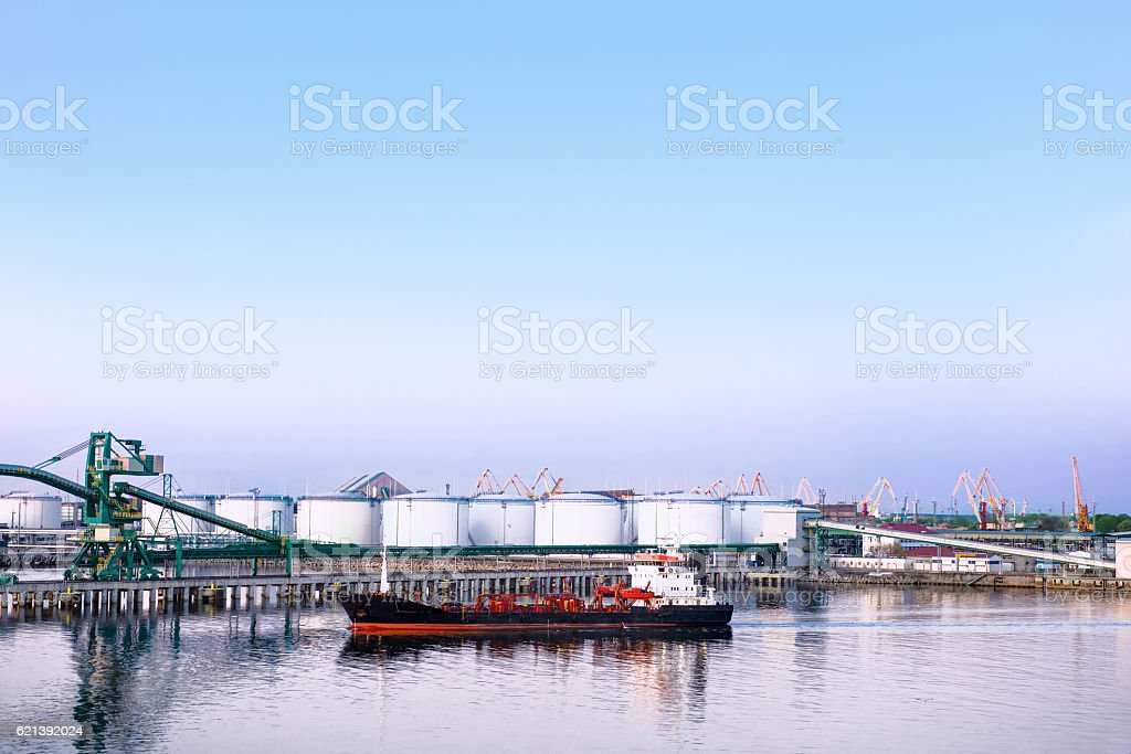 Dry cargo vessel and bunkers at Marina in Ventspils stock photo