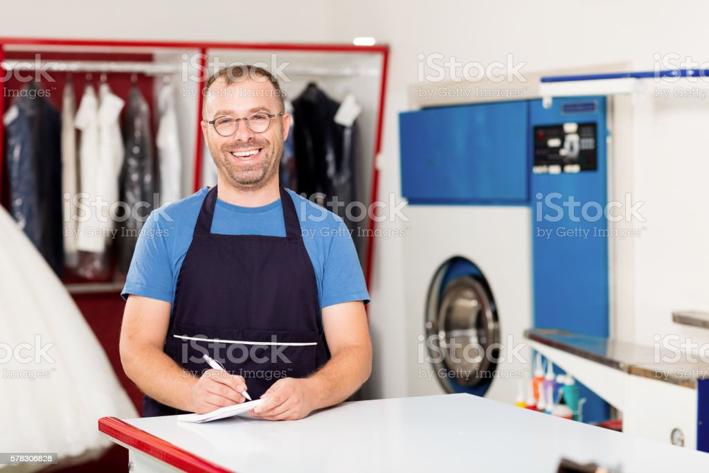 Dry Cleaning Owner stock photo
