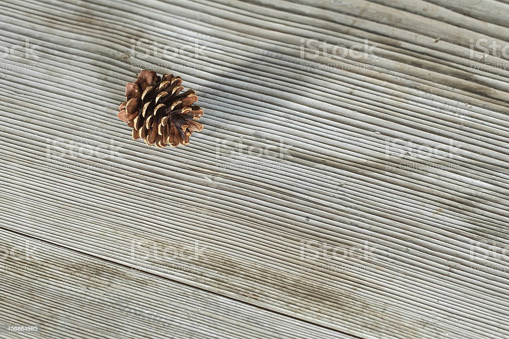 Dry cones on wooden table stock photo