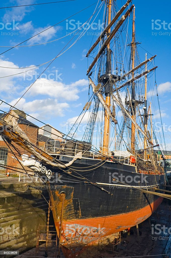 Dry dock and sailing ship stock photo