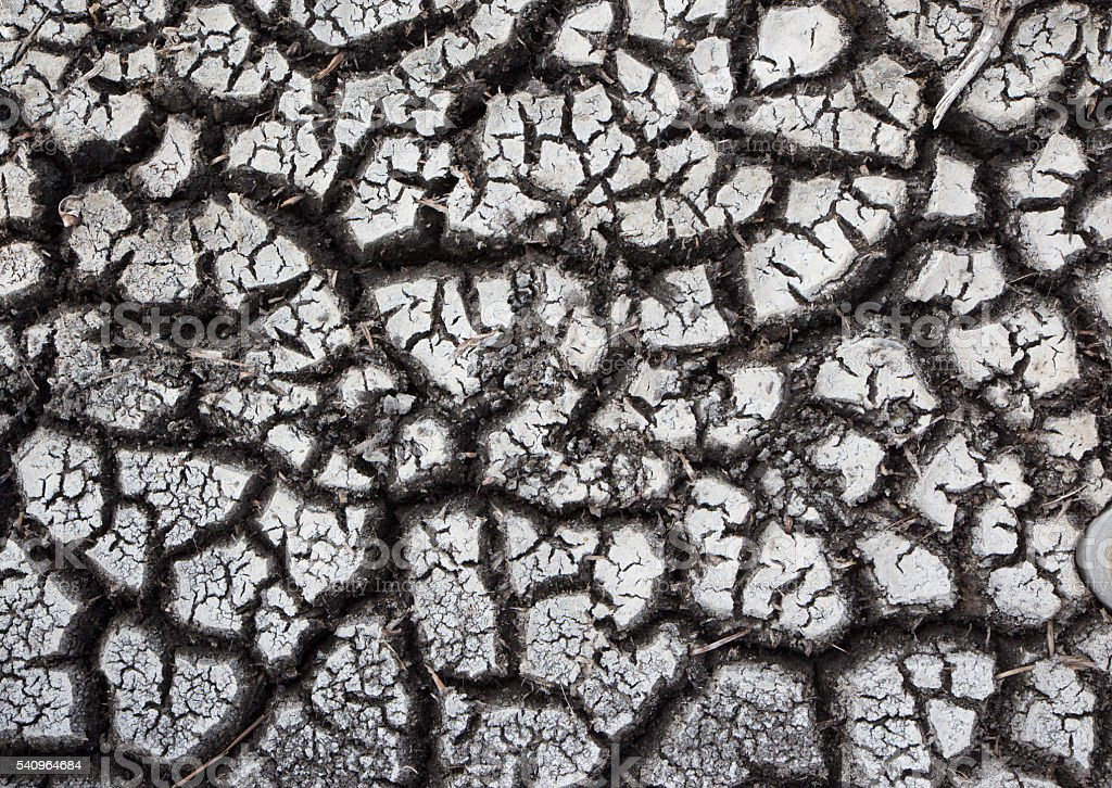 dry earth and cracked ground texture, broken split with soil Стоковые фото Стоковая фотография