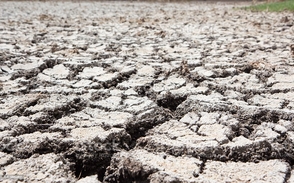 dry earth and cracked ground texture, broken split with soil Стоковые фото Стоковая фотография
