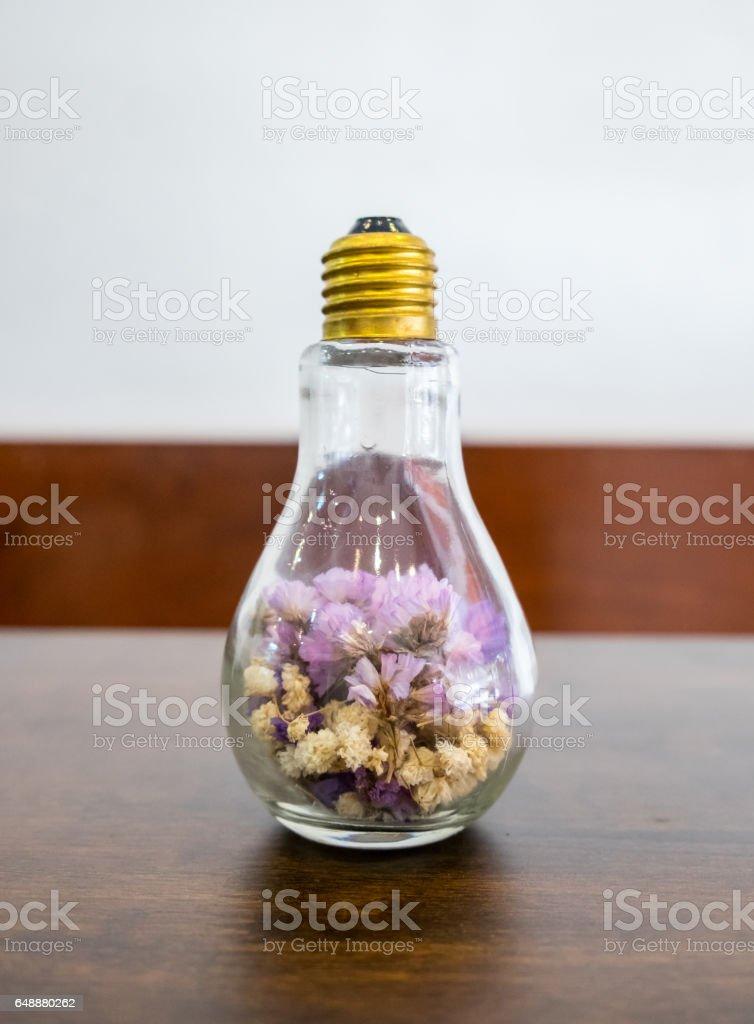 Dry flower in light bulb stock photo