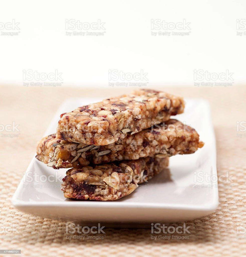 Dry fruit power bar on plate stock photo