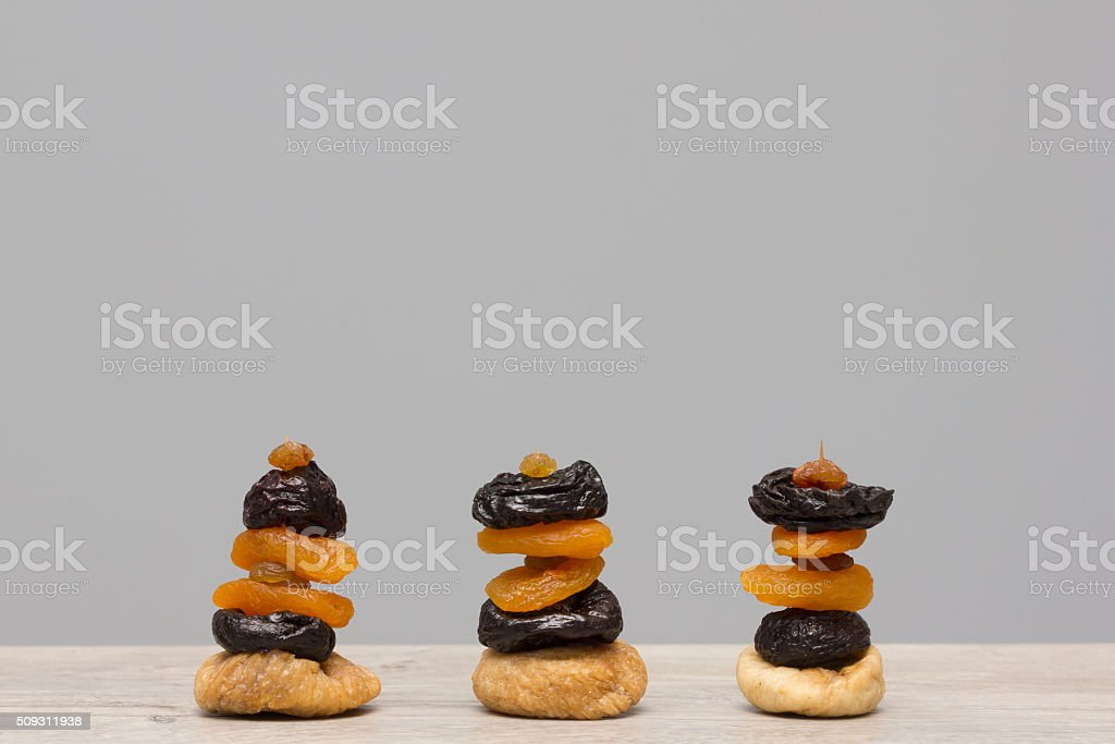 Dry fruit snacks isolated on wooden table stock photo