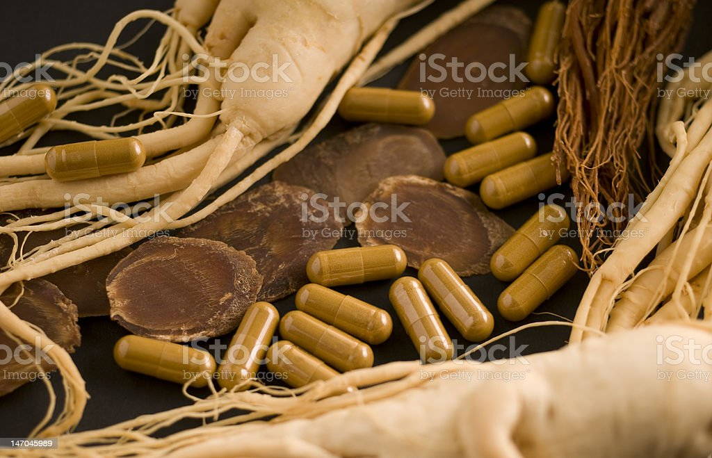 Dry Ginseng Slices, capsules and roots stock photo