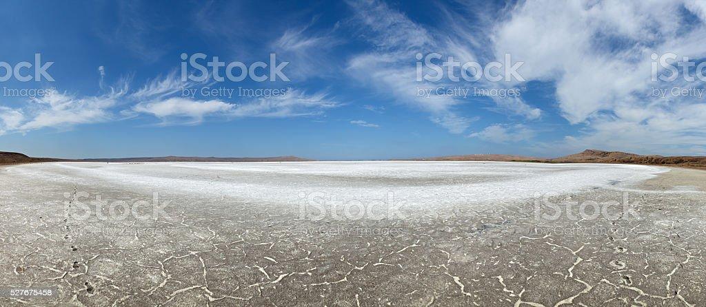 Dry lake under blue sky stock photo