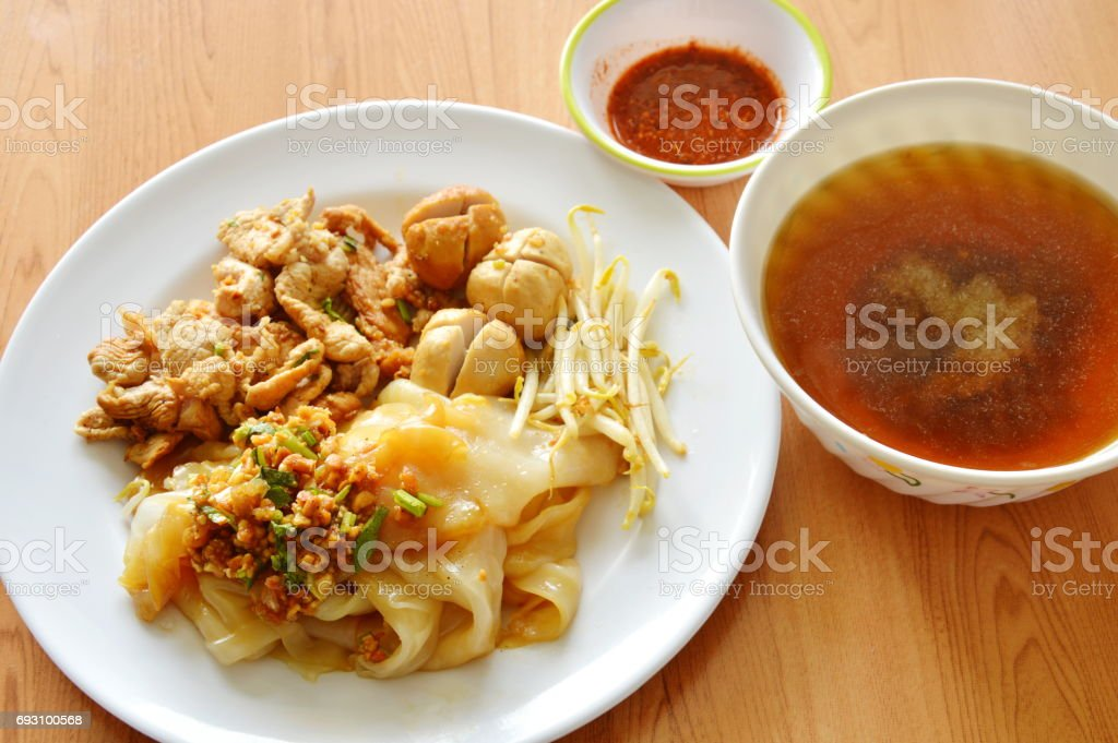 dry large noodle topping boiled pork and soup stock photo