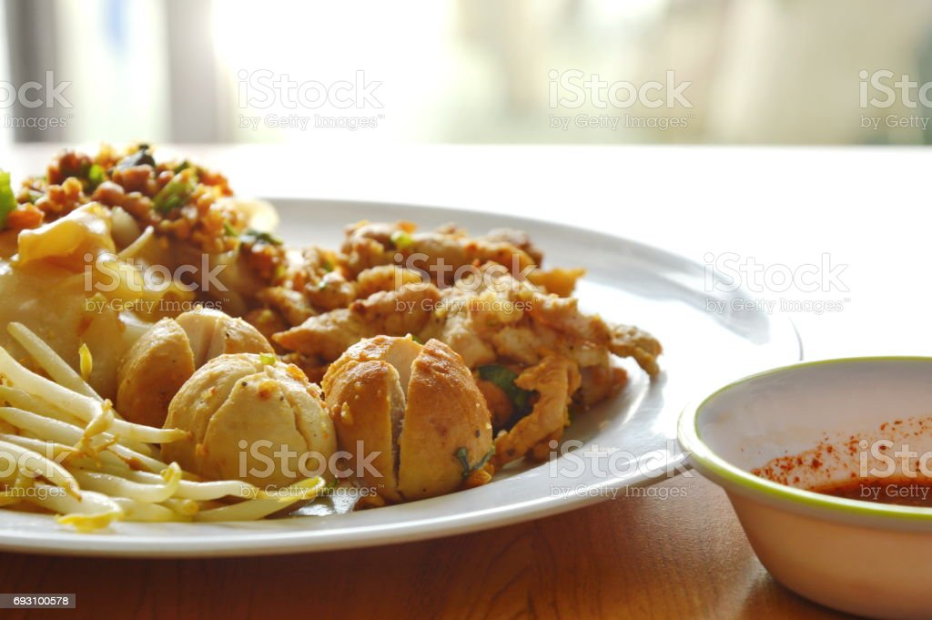 dry large noodle  with pork ball and sauce stock photo